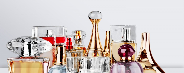 Aromatic,Perfume,Bottles,On,White,Wooden,Desk,At,Wooden,Background